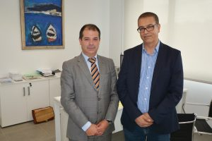 Professor Bouzekri Touri next to dean Rubén Calderón